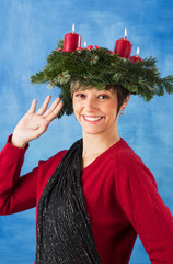 Beautiful woman with advent wreath waving