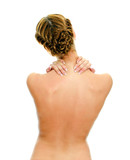 Rear view of young woman with neck pain. Isolated on white.