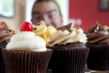 Man Looking at Cupcakes