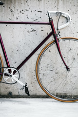 City bicycle and concrete wall, vintage style