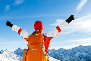 Hiking success, woman in winter mountains