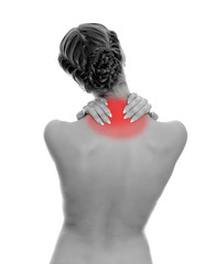 Rear view of young woman with neck pain. Isolated