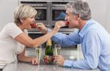 Man & Woman Couple Kitchen Strawberries Champagne
