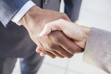 African American Businessman & Woman Shaking Hands