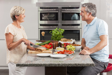 Man Woman Couple Making Sandwiches in Kitchen