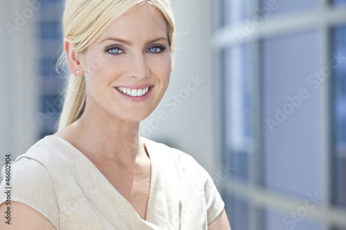 Blond Woman or Businesswoman With Blue Eyes