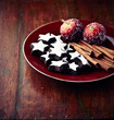 Dark cinnamon stars and cinnamon sticks on a plate