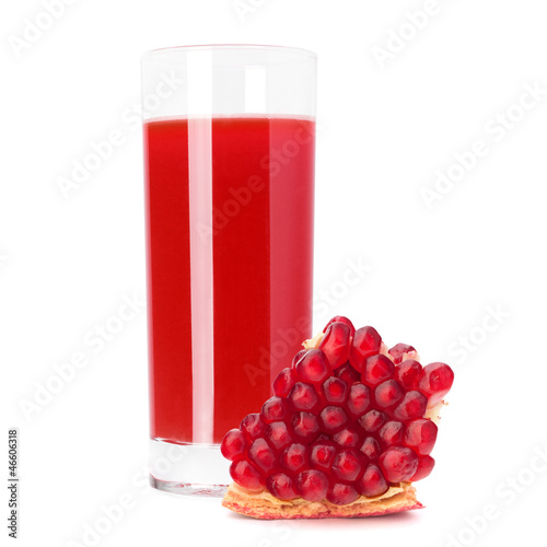 Juice glass and pomegranate fruit