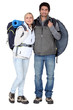 Couple stood with camping equipment