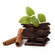Chocolate bars stack and cinnamon sticks