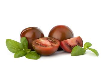 Tomato kumato and basil leaf