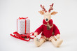 Handmade toy vintage Christmas deer sitting on light background