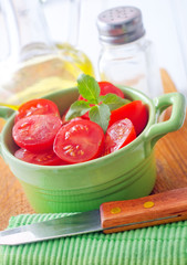 Fresh tomato with green basil in the bowl