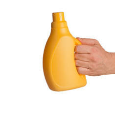 yellow cleaner bottle in hand isolated on white background