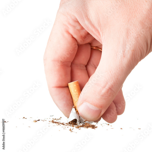 hand extinguishing a cigarette on white