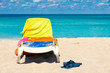 Beach bed covered with colorful towels on a cuban beach