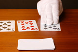 Cards and hand on brown background