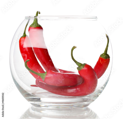 Red hot chili peppers in glass isolated on white