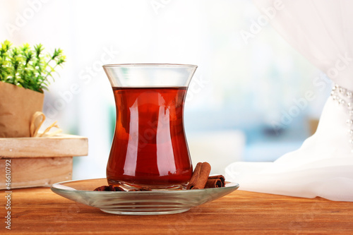 glass of Turkish tea, on wooden table