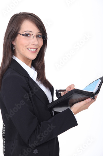 Young woman with a personal organizer