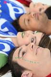 Italian football fans with Forza Azzurri facepaint