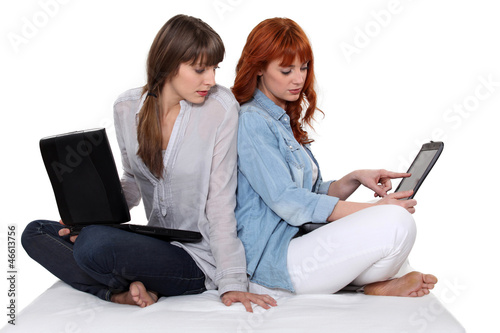 Two girls with computer