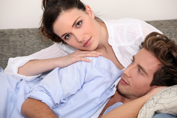 Young couple lying on a couch