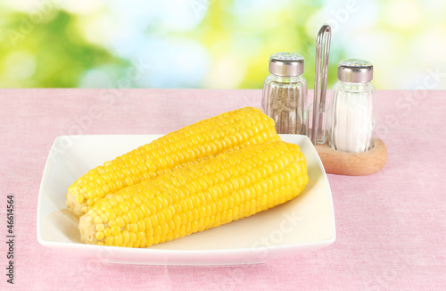 boiled corn on the pink table cloths on the background of