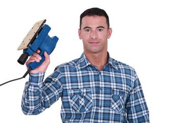 Carpenter holding electric sander