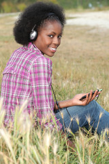 Woman listening to music in a field