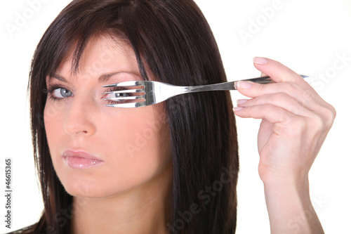 Woman with a fork
