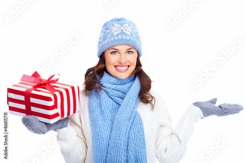 Beautiful christmas girl with gifts.
