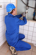 Plumber repairing water pipes