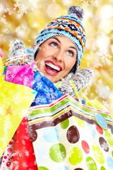 Beautiful christmas girl with shopping bags.
