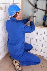 Plumber repairing water pipes
