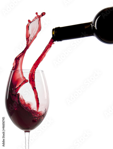 Poster Wijn Pouring red wine in a glass