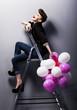 Pretty cheerful fashion retro teen girl laughing on ladder