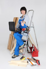 Female carpenter with a laptop
