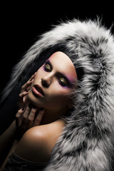 Beautiful tempting woman in a coat with silver fox fur collar