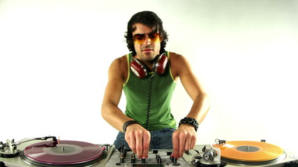 studio shoot of a cool male dj behind the turntables