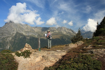 hiker checking directions in French Alps