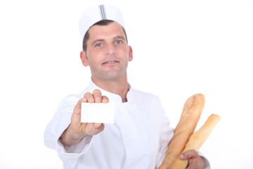 Bakery worker holding out blank business card
