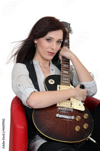Attractive girl sitting with guitar