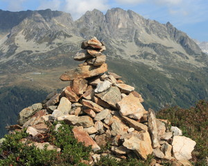 man-made cairn in French Alps