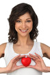 Brunette holding heart-shaped object