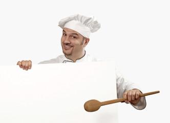 cocinero chef sujetando un panel blanco,retrato de un cocinero.