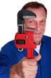 Plumber holding large tool