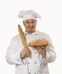 Cocinero chef sujetando un pan fresco.
