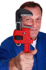 Plumber holding large tool