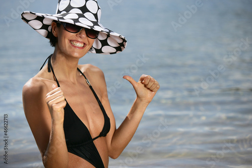 Happy brunette at the seaside